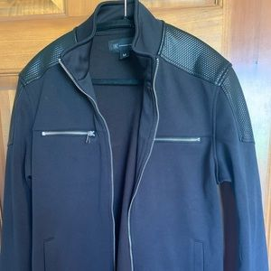 Men's INC zippered jacket with leather detail.
